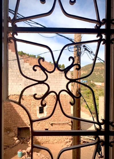 Close-up of metal grate window