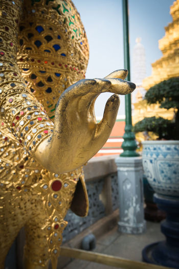 Guardian of Wat Pra Kaew Grand Palace , Bangkok ,Thailand Art Art And Craft Close-up Creativity Day Focus On Foreground Gilded HEAD Mythology No People Place Of Worship Sculpture Statue Wrought Iron