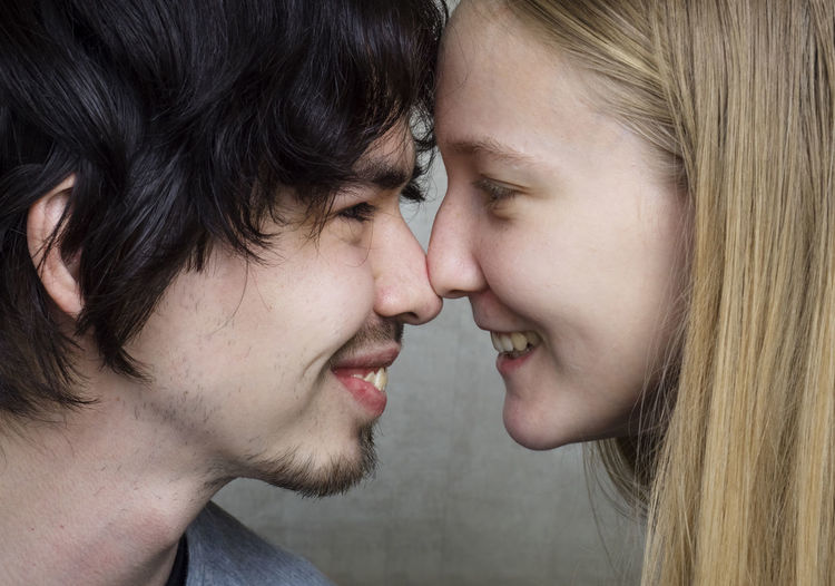 Headshot Two People Togetherness Emotion Close-up Portrait Young Adult Couple - Relationship Bonding Hair Women Young Women Love Positive Emotion Heterosexual Couple Side View Young Men Adult Men Young Couple Boyfriend Hairstyle Human Face Teenager