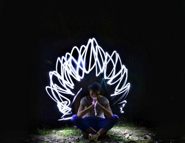 Full Length Sitting Illuminated Dancer Women Females Dancing Performance Portrait Motion Lotus Position Light Painting