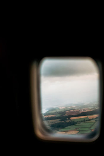 View of landscape through airplane window