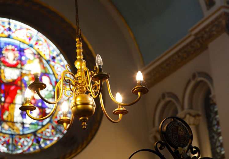 Low Angle View Of Lit Chandelier In Church