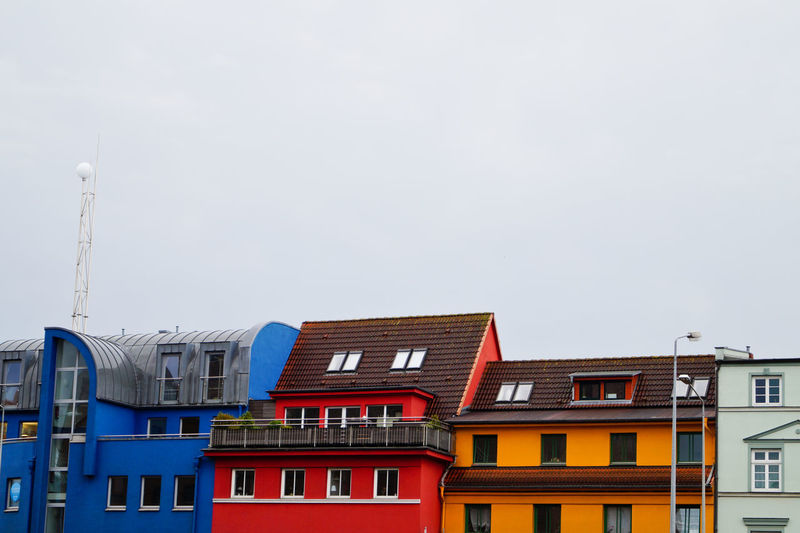 High section of colorful buildings against clear sky