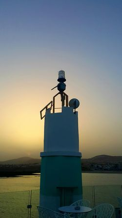 Sunset Warm Tranquility Tranquil Scene Clear Sky City Innovation Cityscape Sunset Silhouette Standing Technology Sky Lookout Tower Tower Lighthouse Tall - High Spire  Tall Lifeguard Hut Observation Point Lifeguard  Shore Urban Skyline Calm Telescope Communications Tower