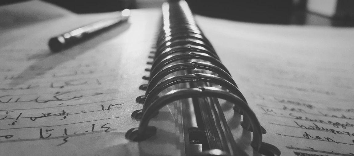 Close-up of spiral notebook