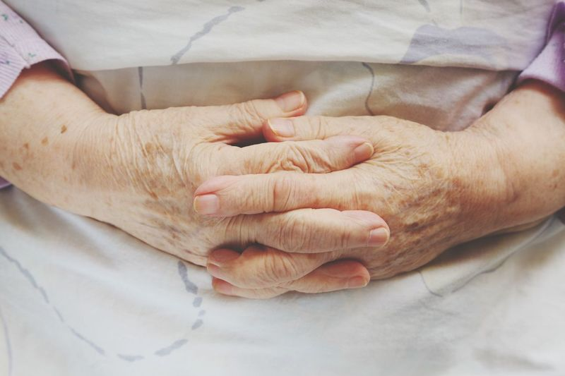Close-Up Of Hands Of Old Woman