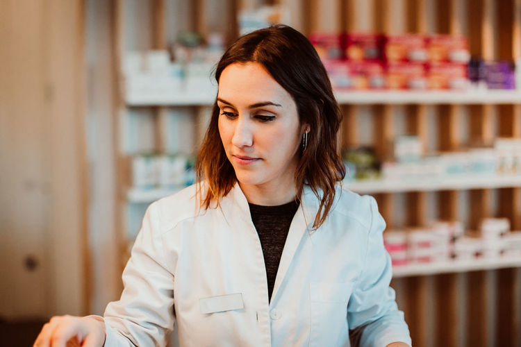 Female pharmacist working at store