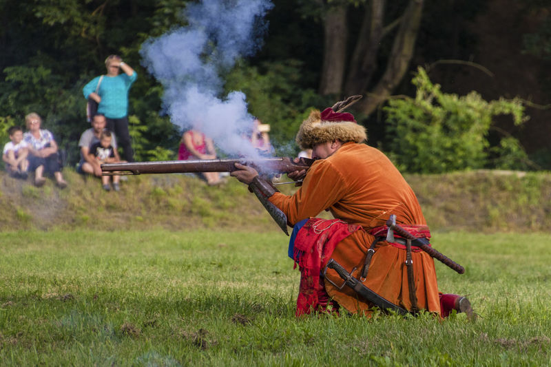 Historical Reconstruction Historical Reenactment Reconstruction Group Costumes Grass Gun Leisure Activity Musket Musketeer People Shot Smoke - Physical Structure Sport Weapon