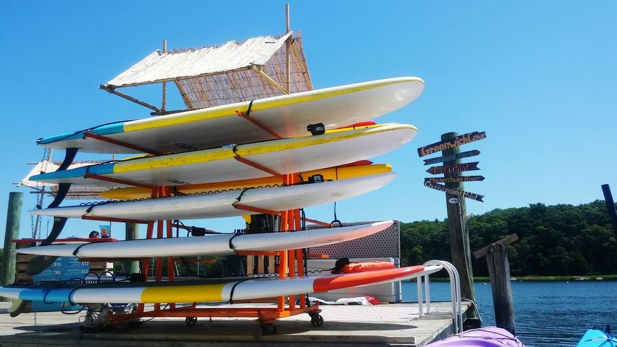 Stack of surfboards against the lake