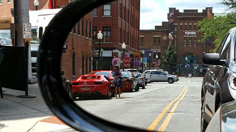 Sneaking a peek in the rear view mirror of a sleek racey subject. Car Transportation Mode Of Transport City Street Road City Life City Street Outdoors Day Mirror Rearview Mirror Rearview Mirrow Racecar Sportscar Red Color Sneak And Peek Land Vehicle Automotive Photography Paint The Town Yellow