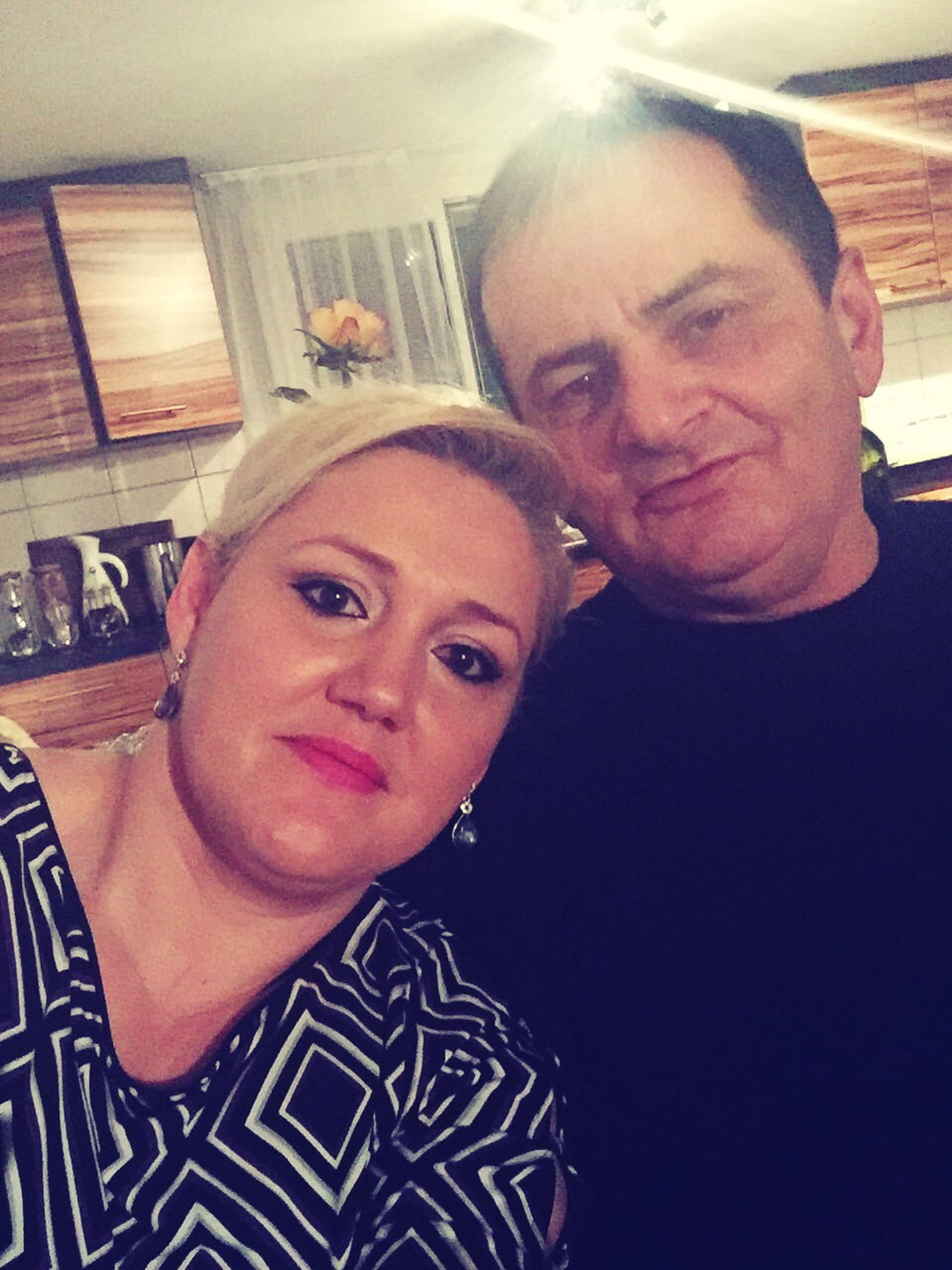two people, looking at camera, portrait, lifestyles, togetherness, heterosexual couple, love, home interior, mature adult, real people, couple - relationship, indoors, young adult, leisure activity, bonding, young women, women, selfie, smiling, men, adults only, beautiful woman, adult, close-up, people, day