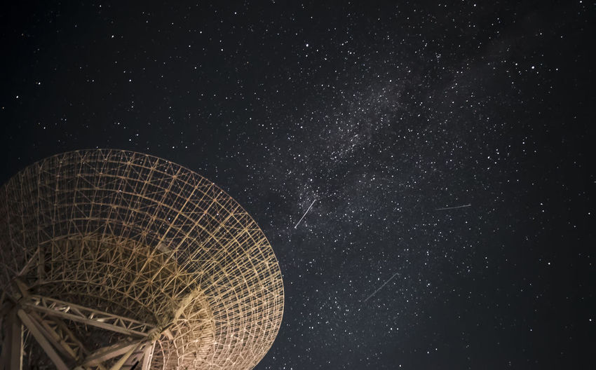 Low angle view of illuminated stars against sky at night