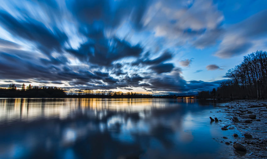 Scenic view of lake against sky at dusk