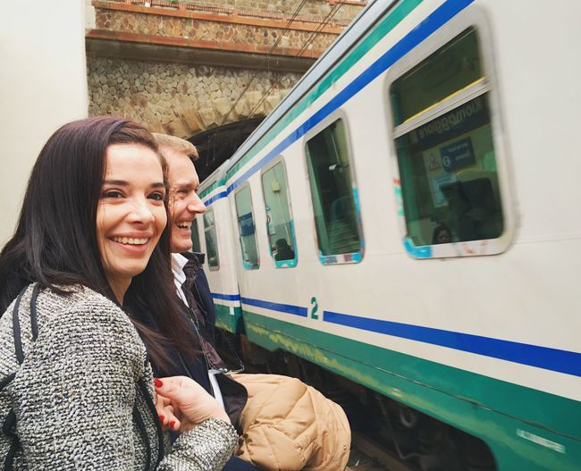 Woman smiling in train