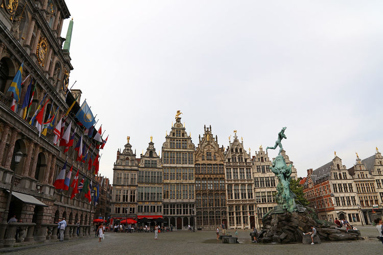 View of Guild Hall and City Hall in Antwerp Architecture Building Exterior Built Structure Sky Building City Travel Destinations History Travel The Past Day Tourism Clear Sky Copy Space Government Guild Hall City Hall House Flags Fountain Landmark Famous Place Copy Space