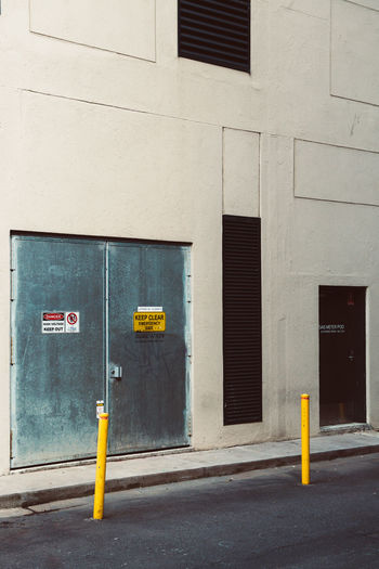 Yellow sign on building by street