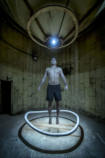 Beam Me Up Science Fiction, Future, Abduction Day Full Length Illuminated Indoors  Leisure Activity Lifestyles Men One Person Portrait Real People Sci-fi Sci-fi Portrait Shirtless Standing Teletransportation Time Travel, Young Adult