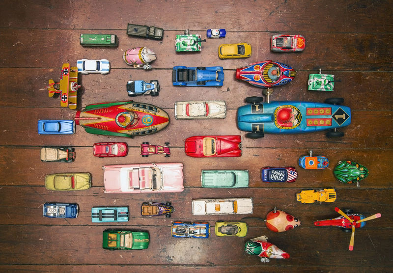 a ot of toy vars shot from above Cars Retro Above View Background Texture Childhood Collection Creativity Large Group Of Objects Multi Colored Rin Toys Toy Toy Cars Collection Vintage Toy Vintage Toy Car Vintage Toys