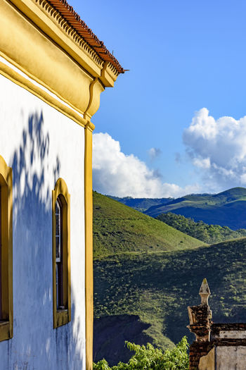 Side view of old church in colonial architecture in the city of Ouro Preto with its mountains and horizon in the background Architecture Brazil Church Minas Gerais Ouro Preto Architecture Baroque Style Belief Brazilian Building Building Exterior Built Structure Cloud - Sky Colonial Architecture Culture And Tradition History Mountain No People Outdoors Place Of Worship Religion Scenics - Nature Spirituality The Past Travel Destinations