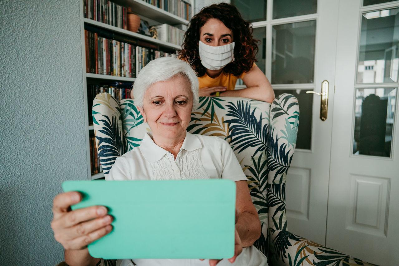 Senior woman and daughter at home