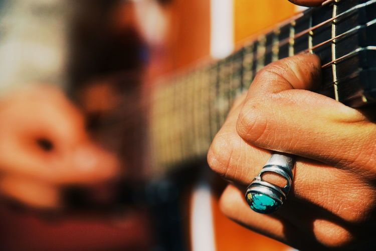 Music at the tip of the fingers Music Musician Guitar Guitarist Portrait Live Music Close-up Fingers Hands Playing Beautiful Capture The Moment Colour Of Life EyeEm Best Shots Conceptual Life Extraordinary  Listen