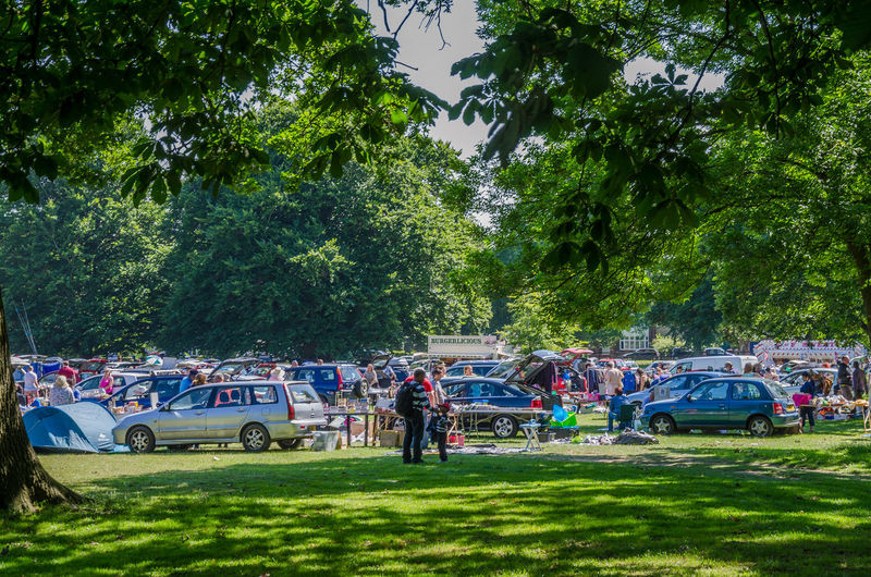 Looking at a car boot sale in Prospect Park in Reading, UK. Busy Camping Car Car Boot Sale Cars Day Grass Green Green Color Growth Large Group Of People Lifestyles Men Nature Outdoors Park Parkland People Reading Real People Summer Sunny Tent Tree Trees