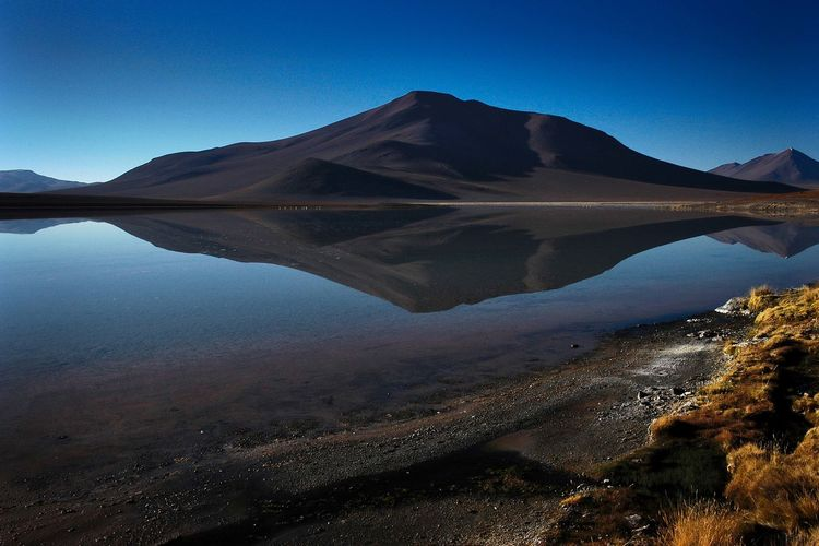 Bolivia Reflection Beauty In Nature Blue Clear Sky Day Environment Idyllic Lake Landscape Mountain Mountain Peak Mountain Range Nature No People Non-urban Scene Outdoors Reflection Reflection Lake Reflections In The Water Scenics - Nature Sky Tranquil Scene Tranquility Water