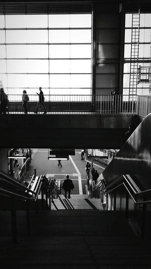 People walking at railroad station