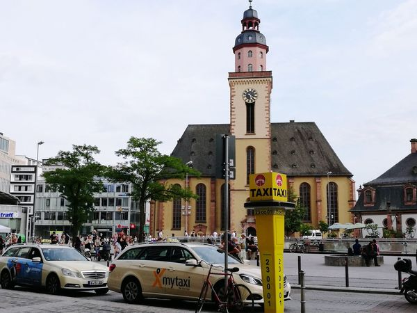 Germany Travel Destinations Clock Tower History Building Exterior Tree Day Outdoors Cloud - Sky Clock Architecture Yellow Taxi City Sky Car Built Structure Clock Face No People Cityscape Frunkfurt Tourism Mobility In Mega Cities Adventures In The City