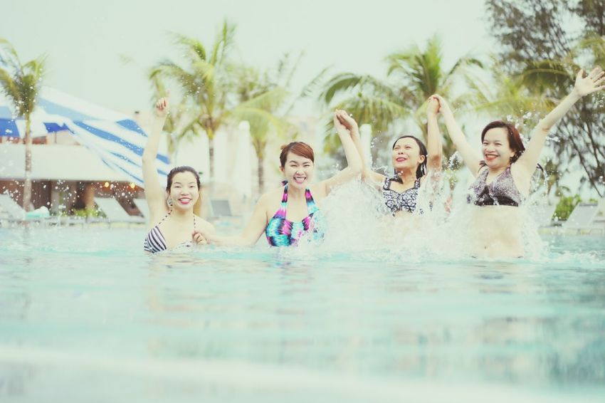 Swimming Pool Water Fun Swimming Happiness Vacations Arms Raised Summer Friendship Togetherness Laughing Enjoyment Wet Smiling People Leisure Activity Excitement Adult Young Adult Cheerful Phu Quoc Phu Quoc,Vietnam Phuquocisland Phu Quoc Island Phuquoc
