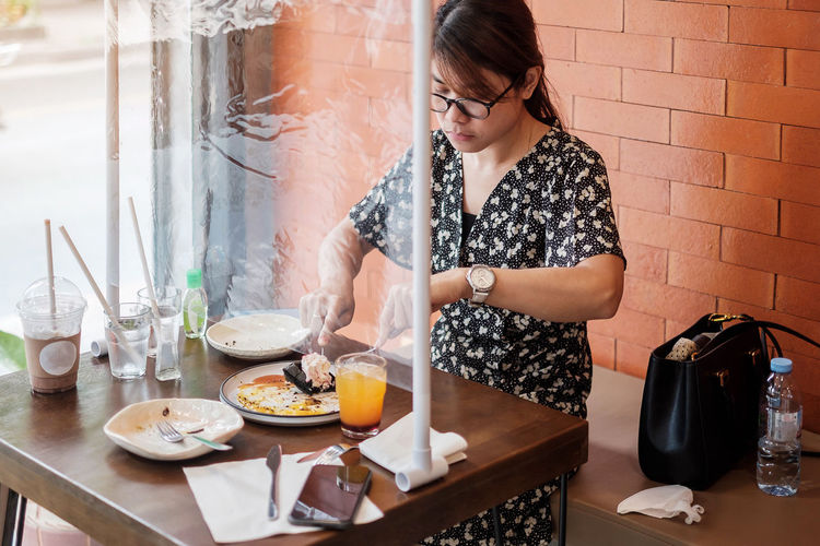 Young woman looking away at table