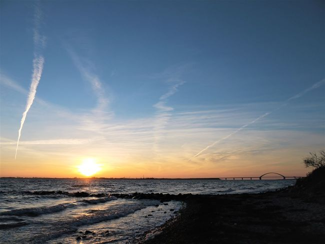 Wulfen Strand Beach Beauty In Nature Day Fehmarnsundbrücke Horizon Over Water Nature No People Outdoors Scenics Sea Shore Sky Sonnenuntergang Sunset Tranquil Scene Tranquility Vapor Trail Water Wave