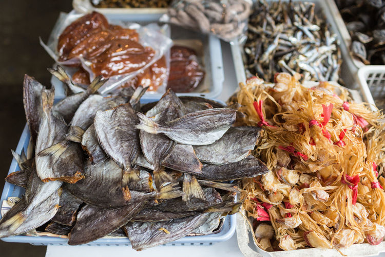 Close-up of dry fish for sale in market