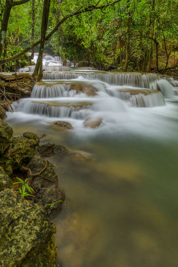 Huay Maekamin Waterfall in Kanchanaburi, Thailand Waterfall Water Nature Forest Scenics - Nature Long Exposure Beauty In Nature Falling Water Outdoors Rainforest No People Flowing Flowing Water Plant Tree Motion Landscape Beautiful Bueaty In Nature Wild Rock Stream National Park Paradise Scene