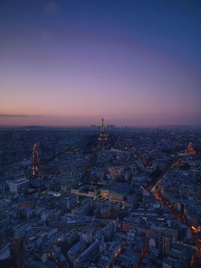 Eiffel tower in city at dusk