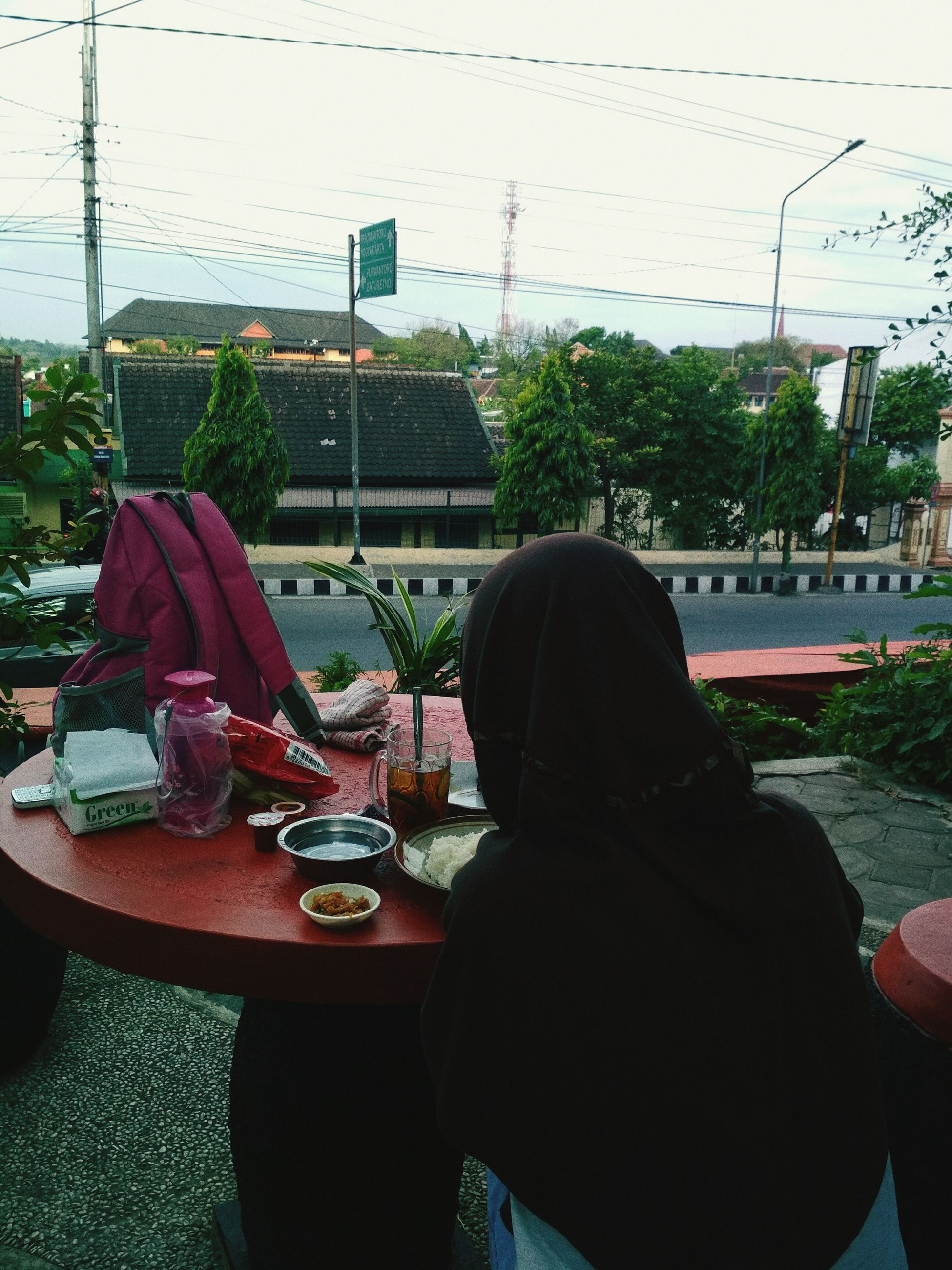 real people, women, one person, table, indoors, rear view, day, architecture, tree, sky, nature, people