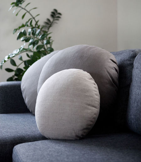 Circle pillows on sofa in living room interior Circle Pillows Close-up Comfortable Cushion Day Home Interior Indoors  Linen Pillows Living Room No People Pillow Relaxation Round Pillows Seat Sofa