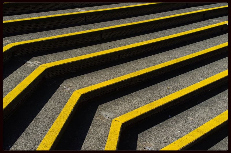 Full frame shot of steps with yellow stripes