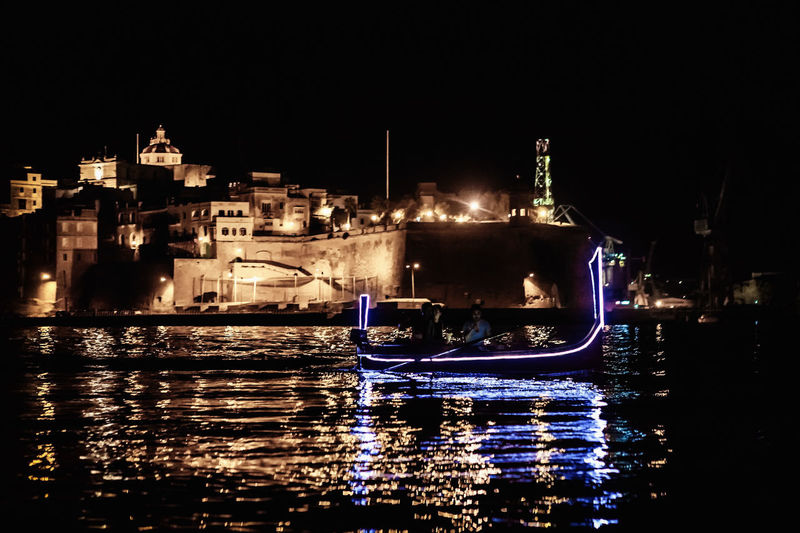 Valletta Harbour by Night Dghajsa Valletta European Capital Of Culture 2018 Valletta Harbour, Malta Valletta Architecture Valletta,Malta Architecture Building Exterior Built Structure City Grand Harbour Illuminated Mode Of Transport Nautical Vessel Night No People Outdoors Sky Valletta Water Waterfront