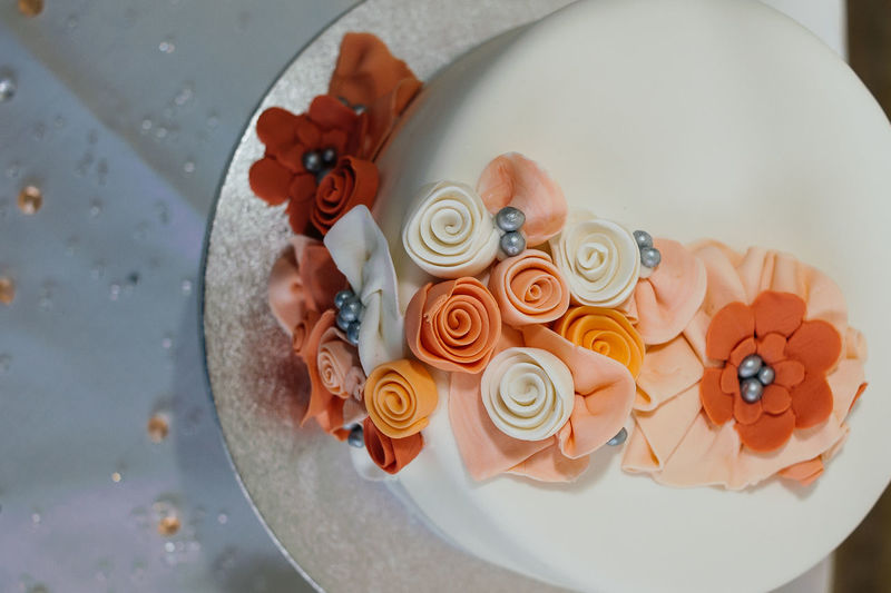 High angle view of decorated of wedding cake on table