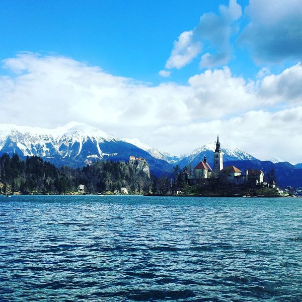 View of the Bled Lake, Slovenia. Its central island with the church makes this place really characteristic and stunning. Slovenia Bled Bled Lake Church Sky Mountains Snow Water EyeEmNewHere