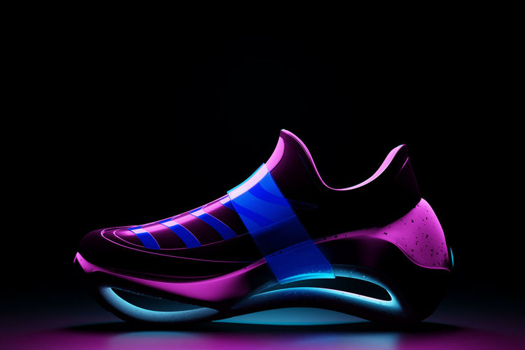 Close-up of shoes against black background