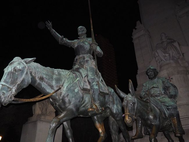 Statue Sculpture Human Representation Art And Craft Art Low Angle View Horse Built Structure Architecture Night Creativity Monument History Stone Material Outdoors The Past Architectural Column Mythology Memories Madrid Sanchopanza