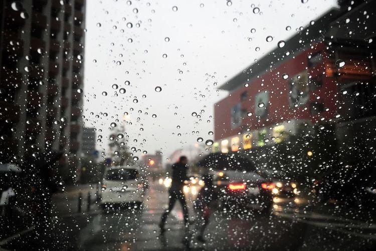 Crossing the street in the rain. Street Rain