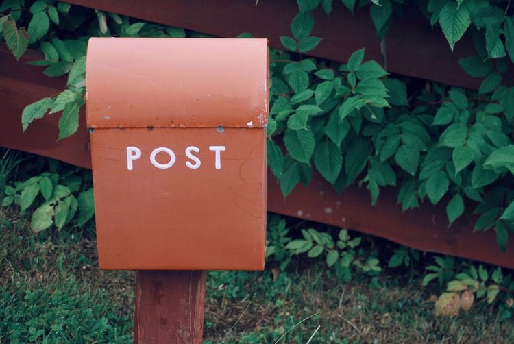 High angle view of text on post box