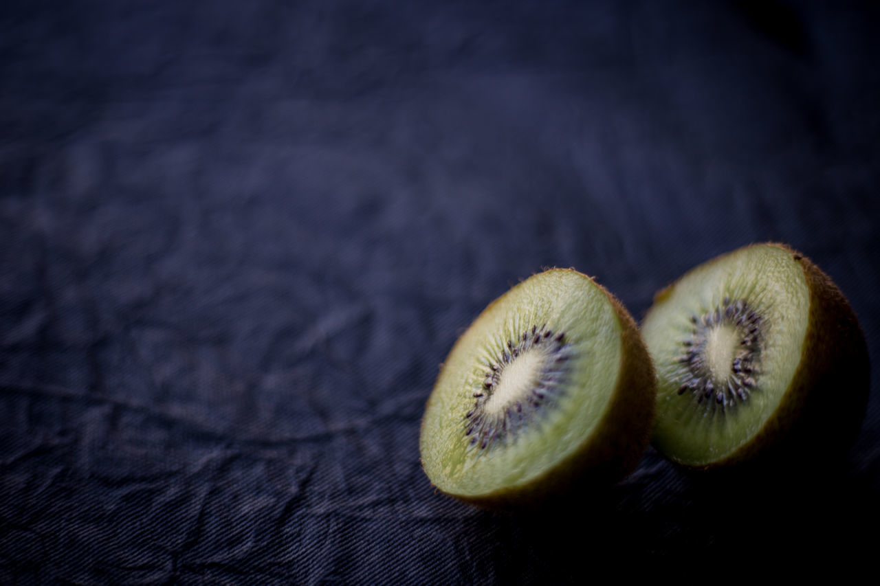 Close-Up Of Halved Kiwis On Table
