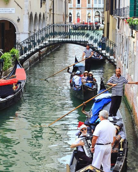 Nautical Vessel Gondola - Traditional Boat Transportation Canal Oar Men Gondolier High Angle View Architecture Rowing Day Real People Water Women Sitting Standing Occupation Outdoors Adult People Venice Venezia Travel Travel Destinations Travel Photography Let's Go. Together. Your Ticket To Europe
