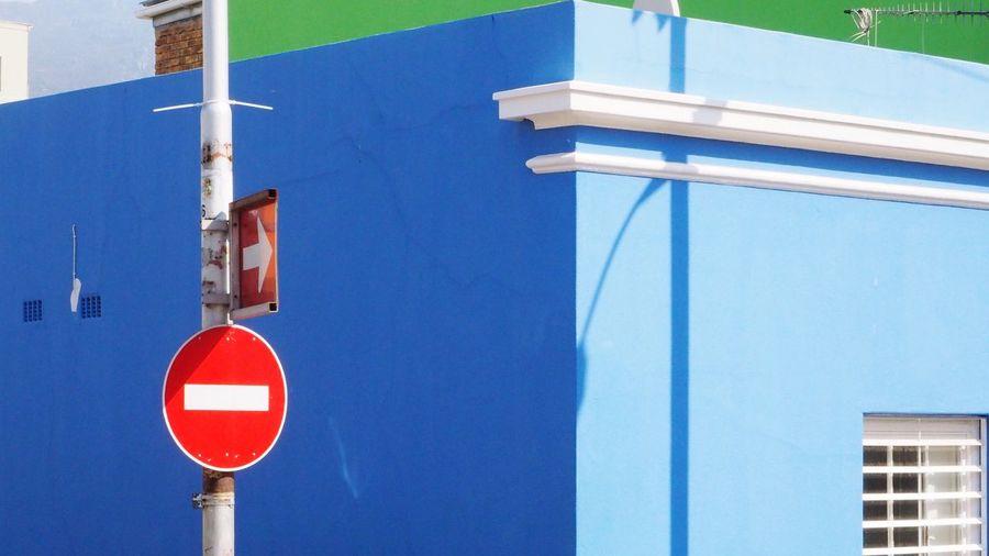 Road signs against buildings in city