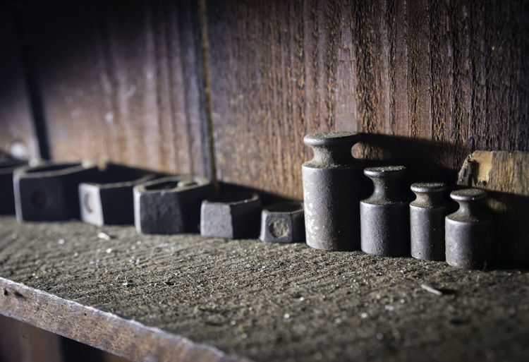 Close-up of weights on shelf