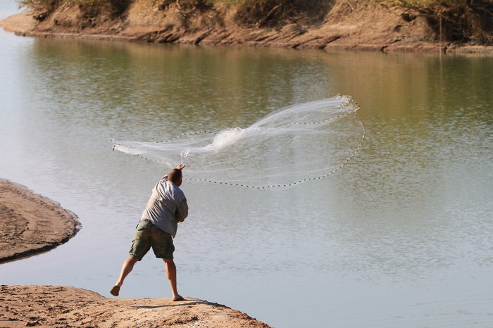 Catching dinner Australian Landscape Australian Outback Beach Beauty In Nature Casting Casting A Net Day Fishing Fishing Net Fishnet Full Length Nature Net One Person Outdoors People Real People Rear View Riverside Rock - Object Sand Scenics Standing Throwing  Water